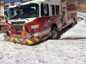 FIRE APPARATUS HITS ICE AND STOPS AT WALL