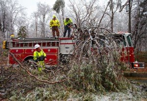Firefighters Trapped by Falling Tree — Responding to Tree on Vehicle
