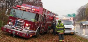 FIRE APPARATUS SLIDES INTO FIRE AMBULANCE AT SCENE
