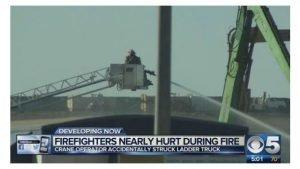 LADDER TRUCK STRUCK BY CRANE AT PHOENIX FIRE